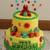 Sesame Street First Birthday Cake Cake I did for my neighbor...her little boy turns one this weekend! She wanted a Sesame Street cake and I did Cookie Monster for his smash...