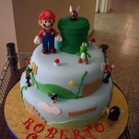 Mario Bros Birthday Cake When I done this cake , I don't have any idea who to do it but I has a plate decoration that was my inspiration. Cake in fondant and...