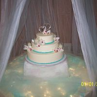 058.jpg Cake adorned with candles and flowers