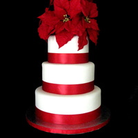 Poinsettia Wedding Cake Customer asked for a simple wedding cake with Poinsettias... I didn't have time to make them out of gumpaste this time, so silk...