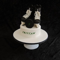 Hockey Skates Cake Made this hockey cake for my 9 yr old son's birthday. RKT hockey skates covered in BC and modeling chocolate. First time attempting...