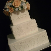 Scrolls & Lace With Rose Bouquet Sugar GP roses bouquet with middle tier done with lace work and other tiers scrolls. TFL