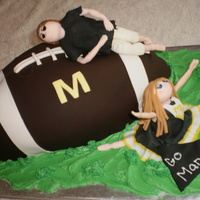 Manets Cheerleading And Football This was a donation cake for the local youth cheerleading and football team. Fondant coverd carved football (first carved football cake)...