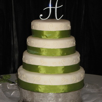 Elegant Wedding Cake My first 4 tiered cake :) Covered in MMF with piped swirls and ribbon on each tier.