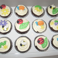 Cute Bug Cupcakes!!! Chocolate cupcakes with vanilla buttercream frosting. All of the bugs and decorations were made out of gumpaste. TFL!