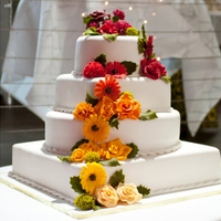 4 Tier Flower Wedding Cake 4 Tier Chocolate Mud & Fruit Wedding Cake.All flowers were made with flower fondant.