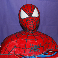 3-D Spiderman Bust Cake My very first 3-D Bust Cake.. Special Made for my nephew's 4th Birthday.. Chocolate & Confetti Cake covered with White Buttercream...