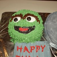 Oscar The Grouch  This is my husband's birthday cake. I only had about 4 hours to bake and decorate this cake, so I am very proud of it. It is French...