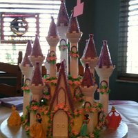 Princess Castle Kit Cake  This was a simple white cake with butter cream and raspberry preserve. Used Wilton Castle Kit and followed directions. I make it look just...