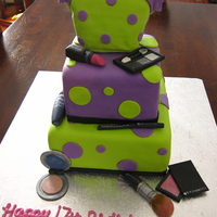 Cosmetics Birthday Cake This cake was for a teen birthday. The make up was all hand made out of fondant and gum paste.