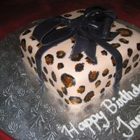 Leopard Print Gift  Here's a birthday cake I made for a lady who loves leopard print. The cake was a dark chocolate malt cake with chocolate malt candy...