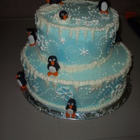 March Of The Penguins   Winter cake with fondant penguins and royal icing snowflakes