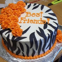 Zebra Cake With Orage Roses  I made this cake for an RA end of year staff BBQ at my university. My staff adviser's favorite color is orange and the zebra stripes...