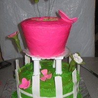 "Mama's Flower Cake 2 10's. 2 6's and 1 8"" for the pot. Buttercream with fondant accents."