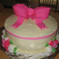 "Donna's Cake 10"" round. Buttercream with fondant accents and roses."