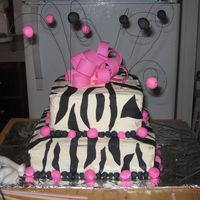 "Katie's Zebra Print Zebra print with hot pink. Buttercream with fondant accents and burst. 10"" bottom and 8"" top."