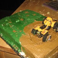 "Hutch's Cake This was the ""throw together"" cake. 11x15 yellow cakes. real fourwheeler. Buttercream frosting."