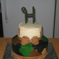 "Hutch's Cake This was his actual cake. 8"" bottom 6"" top. Buttercream camo. Fondant browning symbols and ""H"""