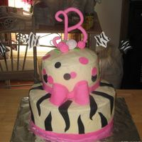 "Brandi's Cake 8"" bottom 6"" top. Buttercream with fondant accents."