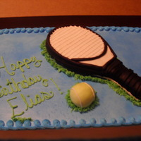 Racket Cake All frosting, except for RKT ball and racket covered in fondant.