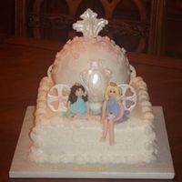 "Carriage Princess   10"" square and ball pan, BC icing and fondant accents. Princesses are made from fondant with BC hair."