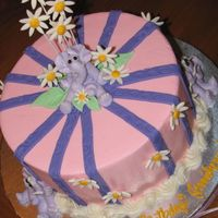"Elephants & Daisies 8"" round w/BC icing, BC elephants, Fondant stripes & daises. Made for a little girl that loves elephants, purple & pink. (..."