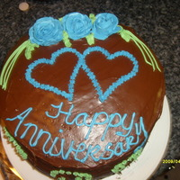 My First Anniversary Cake this is a yellow cake with chocolate icing i did this cake for a friend she loved it....