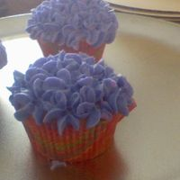 Flower Cup Cakes   I was in a bit of a hurry when i made these but i think that turned out cute.