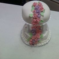 0725091137.jpg   top is done in fondant and bottom is done in BC with fondant roses