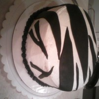 Zebra Cake   A Zebra Cake my sister wanted for her birthday. BC icing and choc. fondant turned black for the stripes.