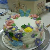0427092013.jpg   My 12 year old sister and I did this cake. I did most of the flowers and she placed them on the cake.