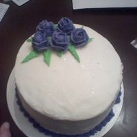 0323092124.jpg   This is the first cake i have ever made. It is all butter cream. The roses look blue but really they are purple.