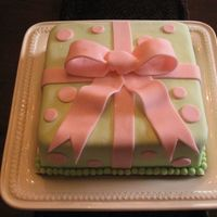 Course 3 Bow Cake First cake for Wilton Course 3. 8-inch square WASC cake. Green is mmf, pink is WIlton Fondant. First time working with Wilton fondant. Not...