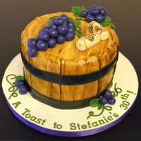 "Wine Barrel 7"" cake. Fondant grapes and corks. Corks and barrel painted with color/vodka mix.Thanks for looking!"