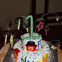 Clowns And Stars crunchy triple chocolate cake filled with caramelized pecans crumbcoated in chocolate buttercream covered with fondantClowns are hand...
