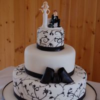 Black And White Wedding 4-8-12 chocolate and vanilla cakes, chocolate icing covered with fondantmy second wedding cake!!! I'm REALLY happy with the results!!!...
