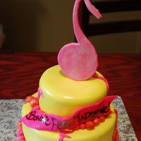 Music Cake strawberry/vanilla cakefilled with fresh strawberriescrumbcoated in chocolate buttercreamcovered with fondant