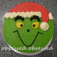 Grinch Saw this one done by Megs1025 and loved it! I knew immediately that this was the cake I wanted to make for the kid's Christmas party...