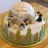 "Penguin Christmas I've seen a lot of penguin/igloo cakes, but everyone puts their own style into theirs. This is mine.10"" base cake with 6""..."