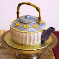 Teapot Cake I'm a big tea fiend. So I thought I'd make a teapot cake to top off our New Years Eve dinner. spout and flowers are gumpaste. &...