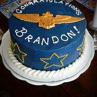 Winging Cake My husband got his Naval aviator wings, and so I made him a cake because it's what I do. It's a chocolate cake with peanutbutter...