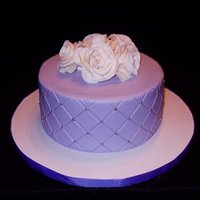 Purple Diamonds Chocolate WASC with milk choco ganache filling. Indydebi buttercream with gumpaste roses.