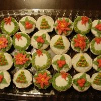 Christmas Themed Mini Cupcakes Mini cupcakes frosted with vanilla butter cream and decorated in various Christmas themes.