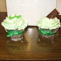 Mint Chocolate Cupcakes Sideview Chocolate cake. Buttercream Icing with Chocolate and mint flavoring (recipe from Wiltons). Applied green fabric ribbon to silver cupcake...
