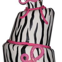 The Lindsay Ii Zebra Print cake with Gumpaste accessories for the 22, L and top back panel