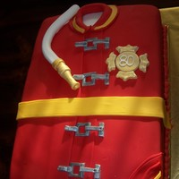 Fireman Jacket A 80th birthday cake for a retired fireman.. Chocolate Espresso, Banana sour cream and vanilla layers with Sweet and Savory buttercream(by...