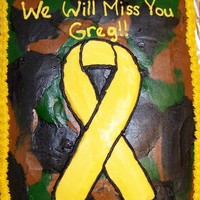 Yellow Ribbon With Camo Background   Yellow cake decorated in buttercream.