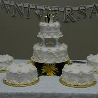 Harris' 50Th Anniversary White cake, white buttercreamicing, royal icing roses dusted with gold glitter. Old photo I ran across and thought I would post my first...