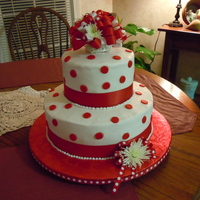 "Red Dots 6"" 10"" Red Velvet, buttercream icing, fondant circles, ribbon and fresh flowers for a bridal shower. Hope they like it!"