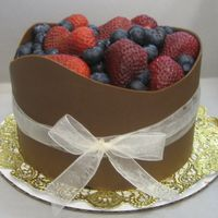 My_Cakes_005.jpg This is a chocolate torted cake filled with chocolate mousse. I wrapped it in chocolate and topped it off with fresh berries. Hope you guys...